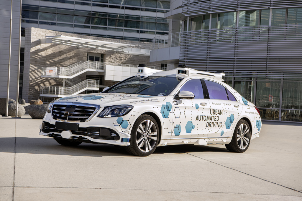A Mercedes-Benz S Class sedan equipped with sensors and labeled